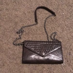 Spiked wallet on a chain